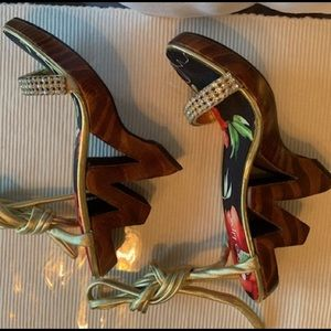 Wedge carved heel sandals with gold ankle strap.
